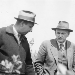 H. G. Huntington (left) of Pender County (N.C.), largest blueberry grower in the state, conferring with Dr. George M. Darrow, senior pomologist of USDA, April 1940
