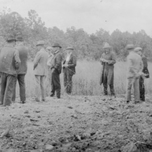 Group of men standing next to a field, part of the soil improvement demonstration, in Surry County, North Carolina, May 1927
