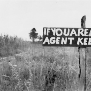 "Sign on land: ""If you are a farm agent, keep off"""