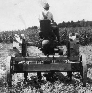 Man riding a tongued plow, ca. 1930s