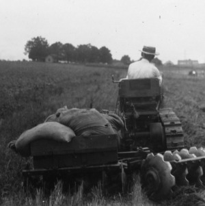 Man demonstrating new type of harrow plow at Farmers' Convention, North Carolina State College, July 26, 1928