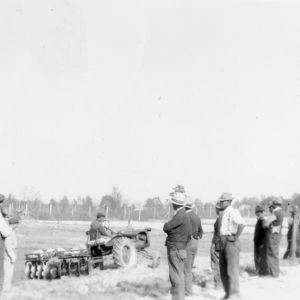 Group of farmers watched tractor demonstration, October 1940
