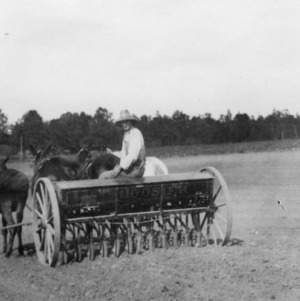 Seeding wheat with large drill, intended to be used with tractor, October 1920
