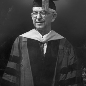 Dean I. O. Schaub in commencement robes