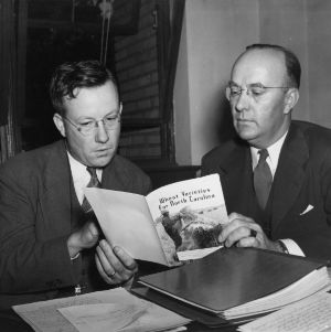 "Dr. L. D. Baver and R. M. Salter reading through ""Wheat Varieties for North Carolina"" booklet"