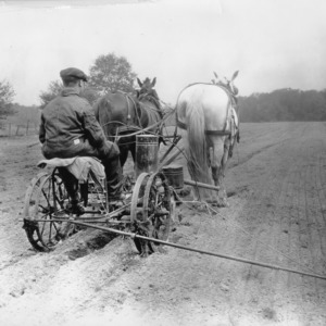 Man preparing a field for planting