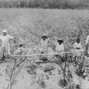 Family in a field with bags filled with cotton, September 15, 1927