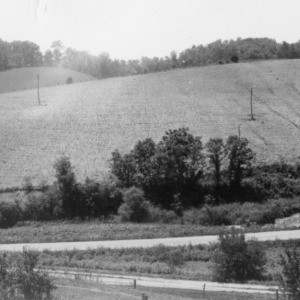 Hill farming of neighbor's farm--top to bottom with much erosion, June 1938
