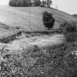 From the road to show damage of stream at bottom of hillside farming, June 1938