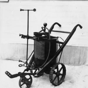 Horse-drawn traction sprayer used in thie traction sprayer-duster studies during 1937