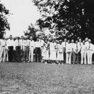 Group photo of men and women outside