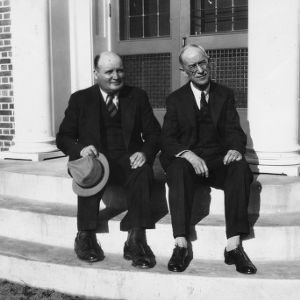 Mr. W. H. White and Dr. Garnor sitting on the front steps of the Oxford Laboratory