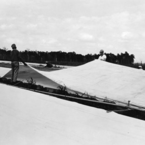 Extra canvas on plant beds at Border Blet station, Whiteville, North Carolina