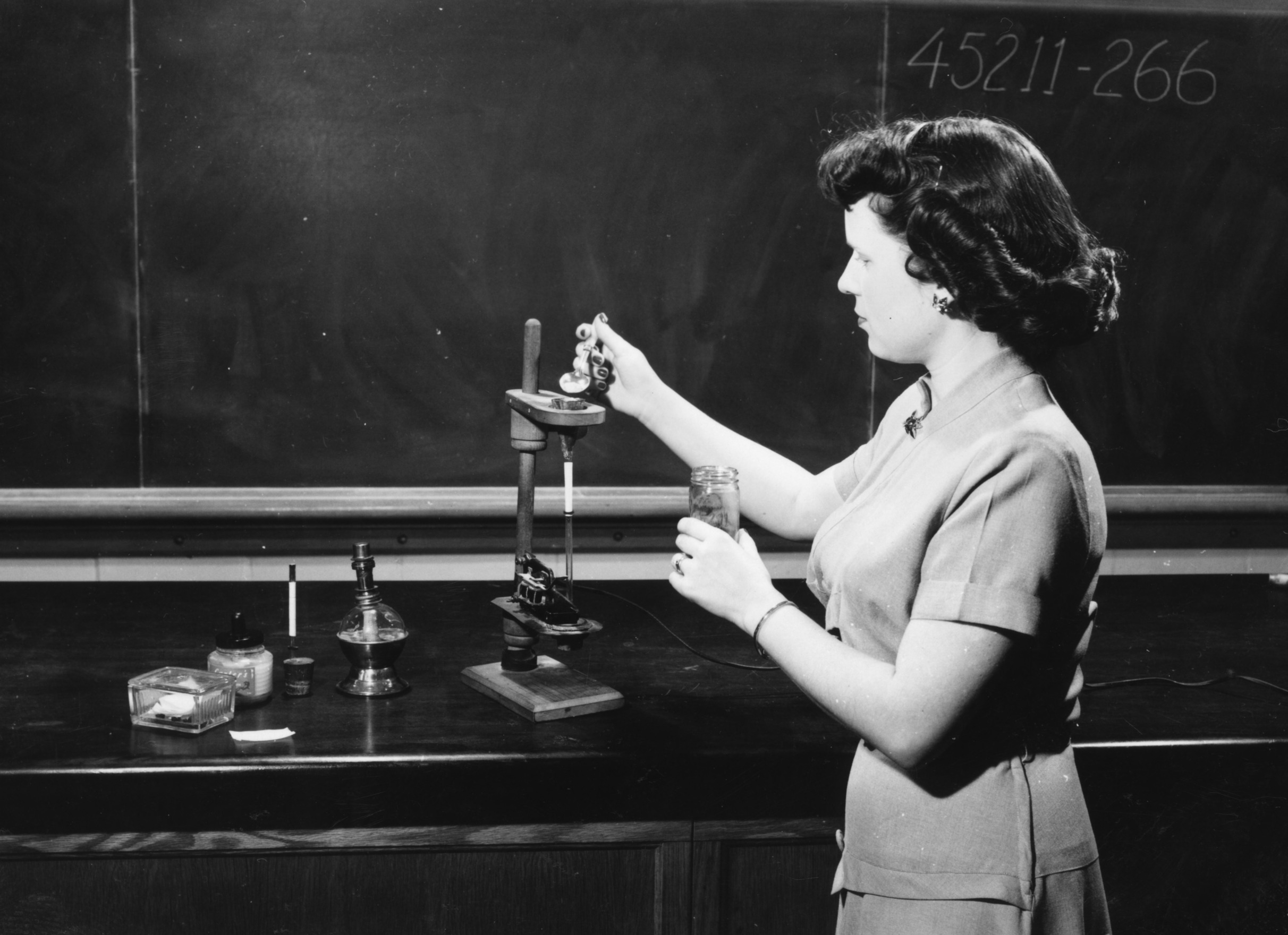Unidentified woman in a tobacco lab
