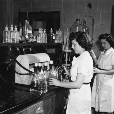 Two unidentified women working in a tobacco lab