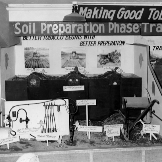"""Making good tobacco better"" display showing the soil preparation stage"