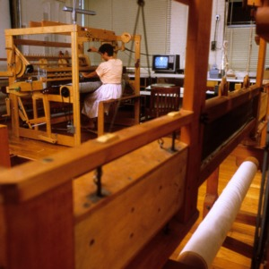 Woman weaving at Centennial Campus
