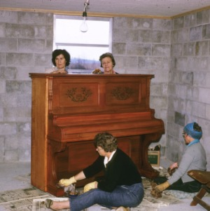 Tyrrell Co., Soundside com. dev, refinishing donated piano - taking off old finish