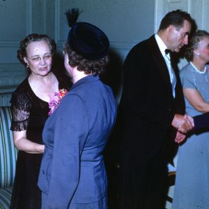 Governor William Kerr and Mrs. Mary Elizabeth Scott greeting women at a formal gathering