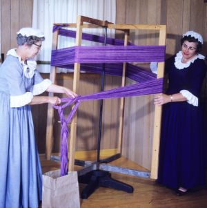 Women preparing yarn for the loom