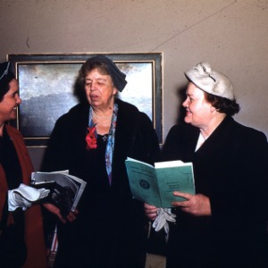 Eleanor Roosevelt visits with two Home Demonstration club members