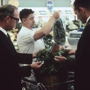 Two men examine vegetables