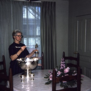 Dining room--home center, Miss Irene Gillam serves from silver service