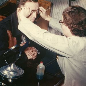 Man being fitted for new eyeglasses