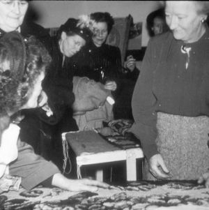 Women looking at a rug