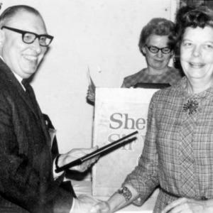 Eloise Cofer receiving a certificate