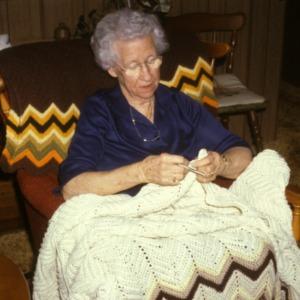 Woman crocheting a blanket