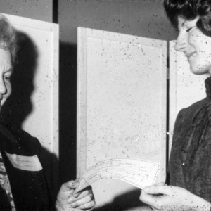 A woman receiving a check