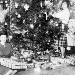 Home Demonstration women setting up Christmas decorations at Broughton Hospital