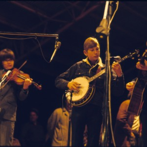 Three young boys performing on stage
