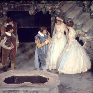 Six people enacting a scene from a play