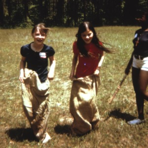 Two girls in a potato sack race