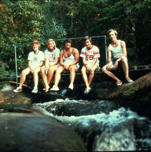 Young people sitting on a bridge