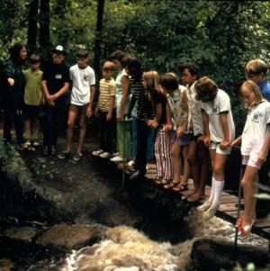Group standing on a bridge