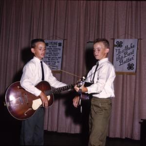 Boys playing guitars
