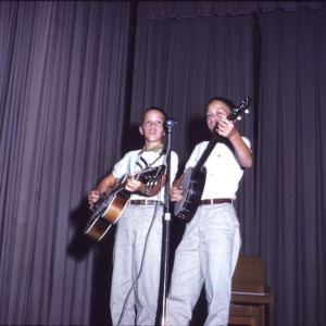 Boys playing guitar and banjo