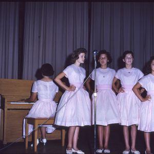 Four singing girls