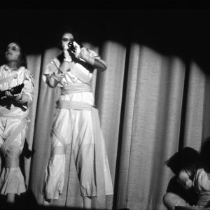 Young women performing a skit as ghosts