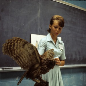 4-H member giving a lecture about an owl