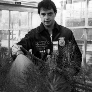 Frank W. Howey, Jr. in greenhouse
