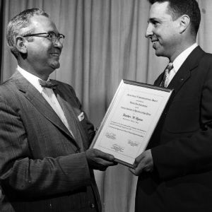 Ted Hyman accepting certificate
