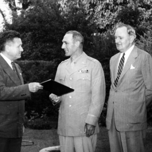 Colonel John H. Harrelson and J. S. Varris present a degree to Major General William Carey Lee