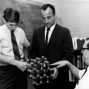 Professor Larry Monteith and Electrical Engineering graduate students examining model