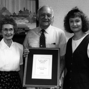 Donald E. Moreland with wife Verdie Moreland, their daughter, and certificate