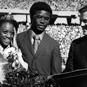 Homecoming Queen Mary Evelyn Porterfield with escort Michael Brown and Alumni Affairs director Bryce Younts