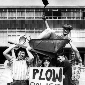 Eric Plow, Student Government Presidential Candidate, 1970-1971, in a wheelbarrow hoisted by supporters